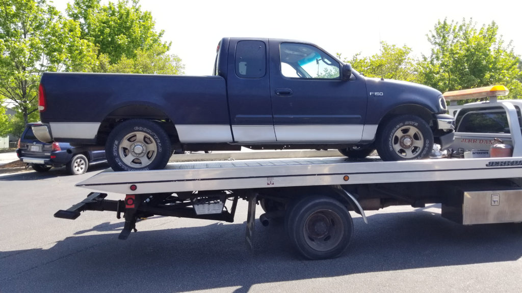 Dead 2001 F150 truck on flatbed